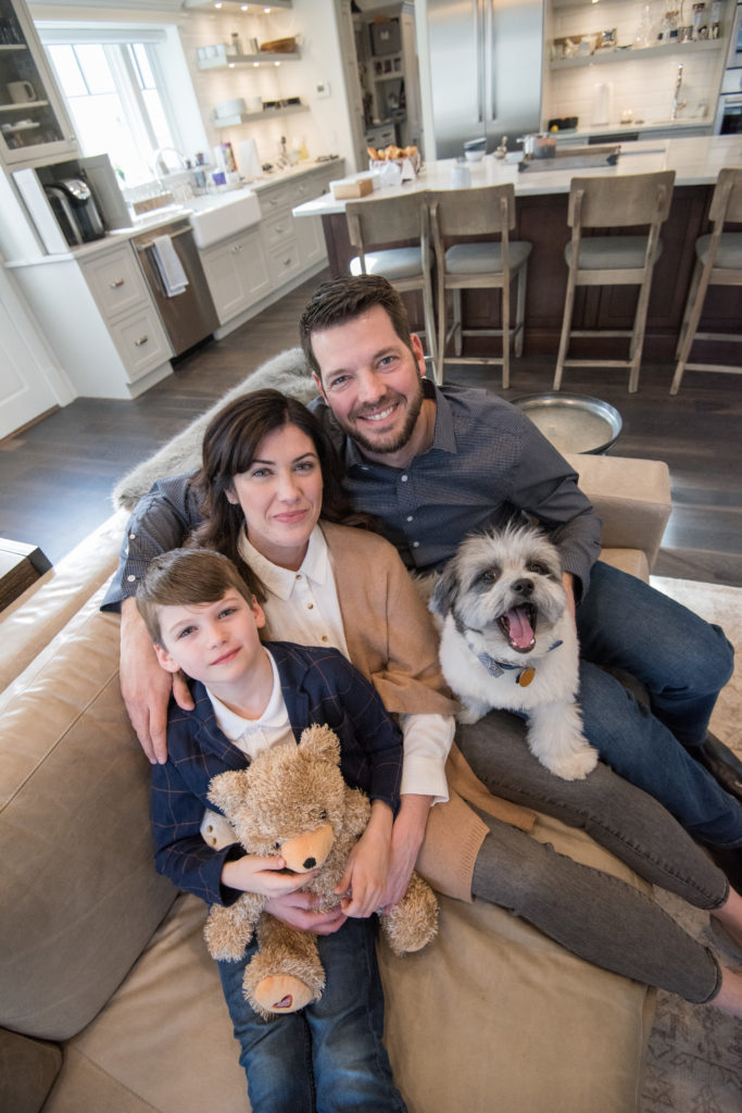 At home in Milton, Massachusetts, Caitlin, Rich and Brice snuggle with dog, YZ.
