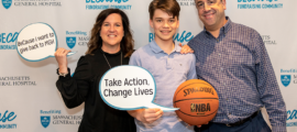 Benjamin Metsch (center), with his parents, Renee Metsch and David Metsch, held a basketball tournament to raise money for breast cancer research at Mass General.