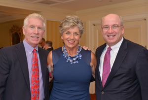 From the left, Mike Schmidt, his wife, Donna Schmidt and MGH President Peter L. Slavin, MD