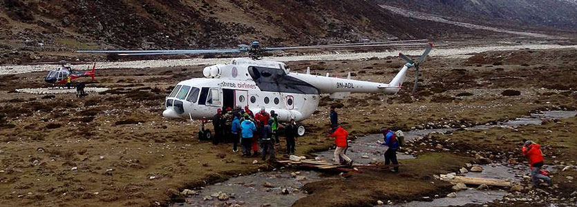 Nepal earthquake victims are evacuated from Pheriche, Nepal via a helicopter carrying 16-18 patients.