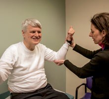 Ann Neumeyer, MD, medical director of the Lurie Center for Autism, examines patient Matt Olson | Autism