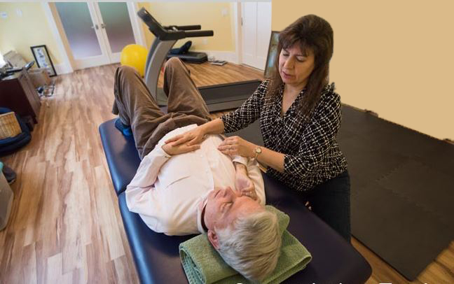At home, Jane helps Stephen with physical therapy stretches.