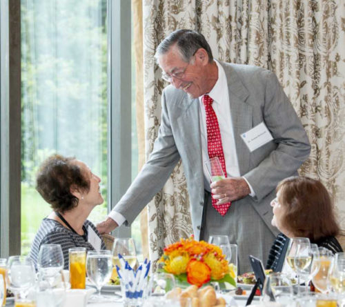Roman DeSanctis, MD, Phillips Society Ambassador and director emeritus of Clinical Cardiology, chats with other society members before the 13th Phillips Society luncheon.