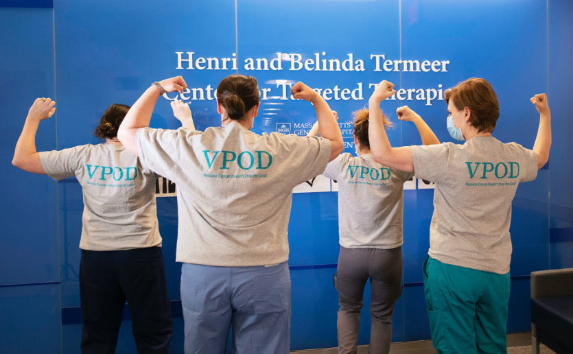 Cancer Center clinicians showed off t-shirts for the Viral Providers of the Day (VPOD) team which worked to evaluate patients for COVID-19 symptoms.