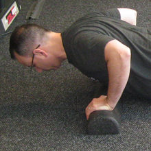 Push-ups are a good exercise for a cold weather workout. A half foam roller can be used as pictured, but it is not necessary.