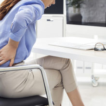 Poor posture and sitting at desks for long periods can lead to pain.