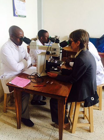 Mass General associate pathologist Drucilla Roberts, MD, (right) helps train residents at Mbarara University of Science and Technology (MUST) in Uganda.