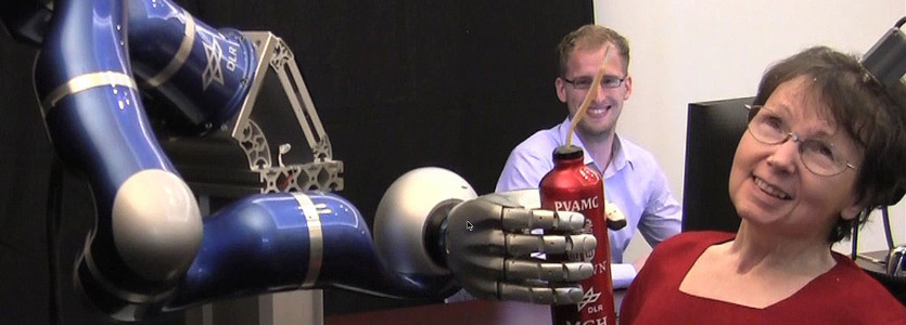 Cathy Hutchinson used a robot arm to serve herself a drink for the first time in 15 years.