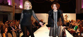 Sally Waite (left) and Theresa McDonnell, DNP, on the runway at the Coutour for Cancer Care event.