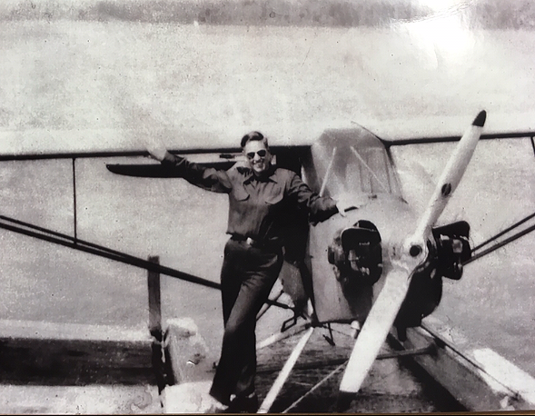 As a young employee of his family's mill and woodworking business, Henry Saunders flew an amphibian airplane over vast acres of sustainable northern New England forestland.