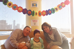 Nicole with her parents, Gerald and Maureen Schindler, celebrating her last day of chemo.