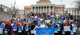 Mass General staffers and supporters pause at the State House on their march to the science rally on the Boston Common.