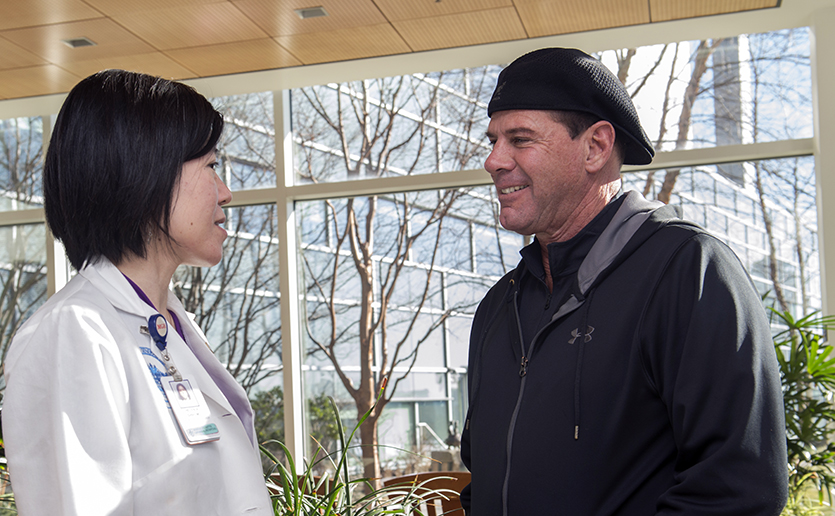 Patient David Fontaine meets with his radiation oncologist, Helen Shih, MD.