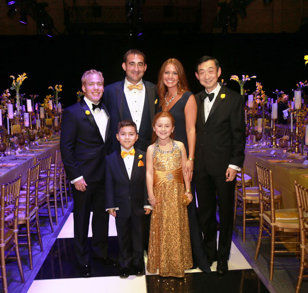 The Robledo family with Reese's caregivers. Pictured clockwise from top: Rob and Mareesa Robledo; Qian Yuan, MD, PhD; Reese Robledo; Mack Robledo; Wayne Shreffler, MD, PhD.