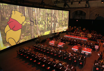 Decor for the 2016 Storybook Ball included handmade clouds, an 18-foot beehive and a giant screen with custom animation.