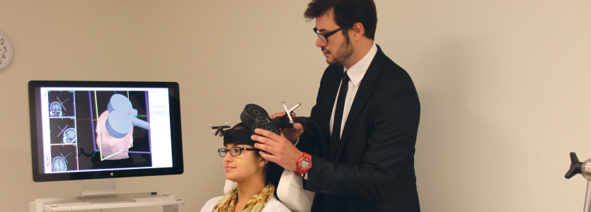 Joan Camprodon, MD, MPH, PhD, demonstrates the use of TMS (transcranial magnetic stimulation)