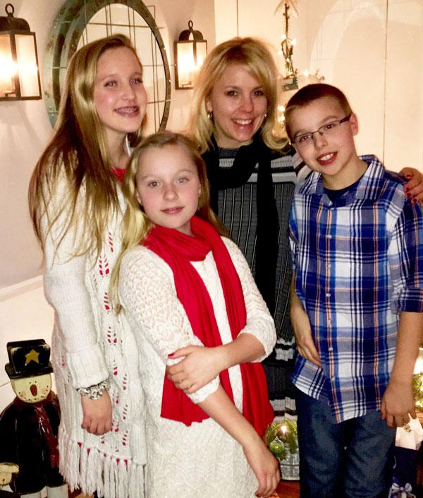 Beth Brooks (center) with her children, from left, Caroline, Ava and Jack