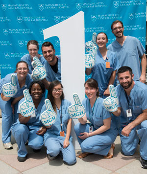 US-NTo celebrate Mass General topping the U.S. News and World Report Best Hospital list, employees posed beside a giant number one. ews-Big-Number-2