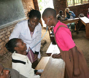 Mass General's Adeline Boatin, MD, MPH (center), believes her presence in Mbarara encourages female colleagues there who are pursuing medical careers and that it has an impact in Uganda