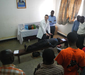 Nirma Bustamante, MD, demonstrates techniques to potential first responders in order to positively impact the healthcare system in Uganda