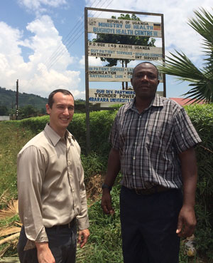 Mass General's Geren Stone, MD (left), at the Bugoye Health Center with Shem Bwambale, the clinical officer in charge.
