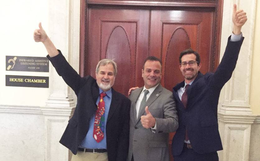 In 2018, Massachusetts became the sixth state to raise the age to 21 for tobacco and nicotine sales. Celebrating are, from left, Lester Hartman, MD, state Rep. Paul McMurtry and Jonathan Winickoff, MD, MPH.