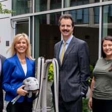 Earl and Maria Winthrop join oncologist Steven Isakoff, MD, PhD, and Dina Hagigeorges, clinical research coordinator to display the scalp cooling equipment that helps protect chemotherapy patients from hair loss.