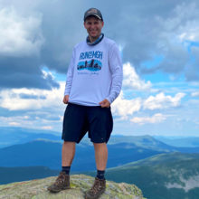 Michael York at the summit of South Twin Mountain in New Hampshire (4,902ft) during a 33-mile hike, with Mount Washington in the background.