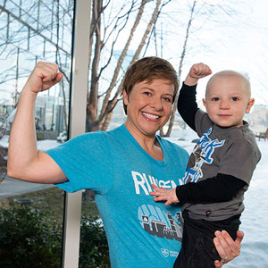 Tarrah Zedower, pictured with her son, Caden, decided to run the Boston Marathon after reading about how underfunded cancer research is.