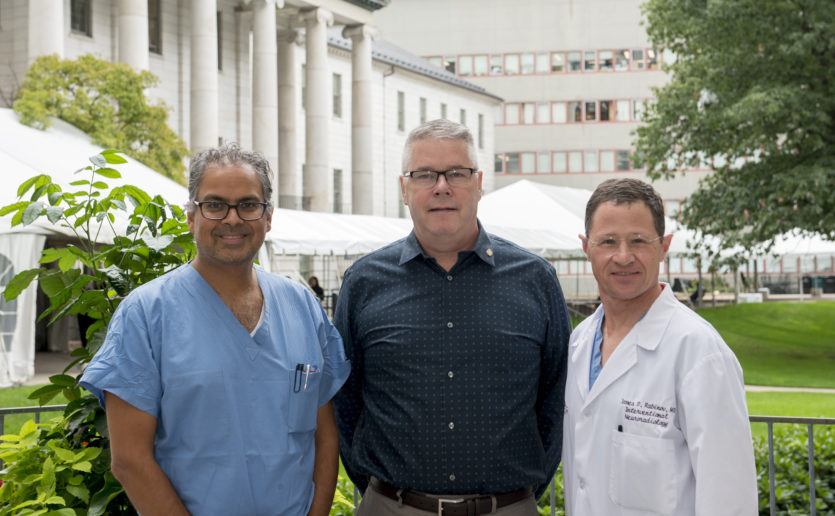 Pictured, from the left, areAmanPatel,MD; BrianSnell and James Rabinov, MD.Drs. Patel and Rabinov treated Mr. Snell at Mass General after he suffered a brain aneurysm.