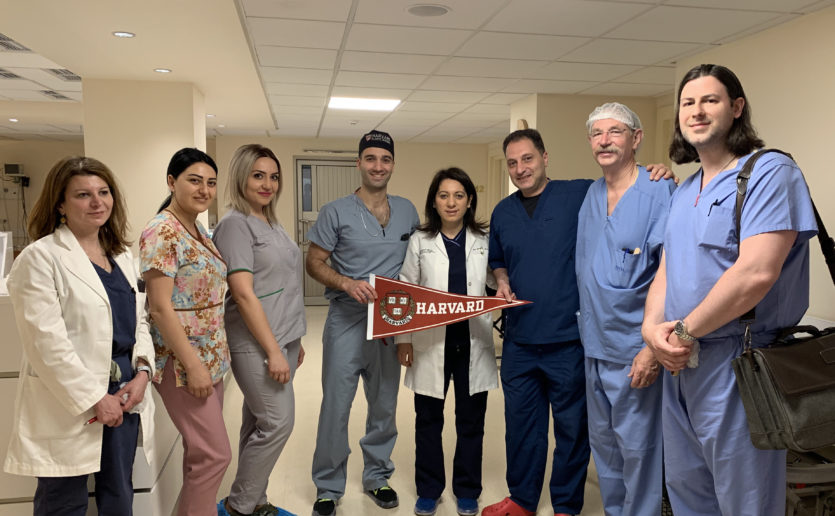 Members of a team from Mass General and Harvard pictured with staff at a laser clinic in Armenia.