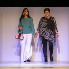 Lisa Sisco (right) walked the runway with her oncologist, Lipika Goyal, MD. Lisa is receiving chemotherapy for a rare form of cancer called cholangiocarcinoma.