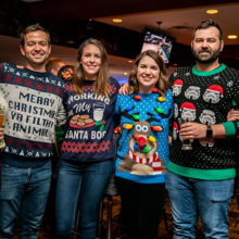 L-R: Kristen Curran, Andrew Curran, Victoria Kane, Elizabeth Schwartz, Tom Curran, Liz Curran at the Ugly Christmas Sweater Bar Crawl in December. Photo: Amanda Kowalski