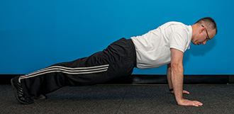A few quick push-ups can help you get some exercise into a busy holiday season.