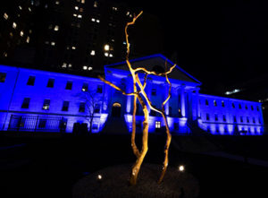 The Bulfinch building lit up in blue, to show appreciation for frontline workers in the community.