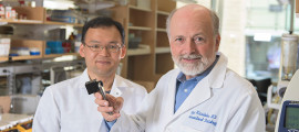Ralph Weissleder, MD, PhD, holding a new smartphone device, with Hakho Lee, PhD. They are members of the Mass General team that created the technology.
