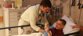 Ari Cohen, MD, helps a pediatric emergency department patient.