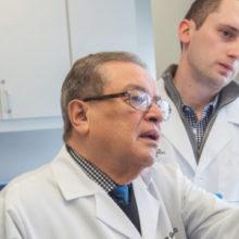 Dr. Ernesto Gonzalez-Martinez treats patient Rafael Bernard (right) as medical assistant Yesenia Gonzalez (no relation) and Nathanial Miletta, MD, look on.
