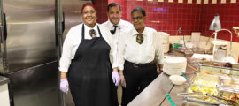 Mass General Eat Street Café staffers (from left) Seandel Grant, Jorge Santana and Paula Brathwaite leave excess food in the warmer to be put aside at closing for Food for Free.