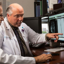 Michael R. Jaff, DO (right), chair of the Mass General Institute for Heart, Vascular and Stroke Care, reviews an image with a colleague.