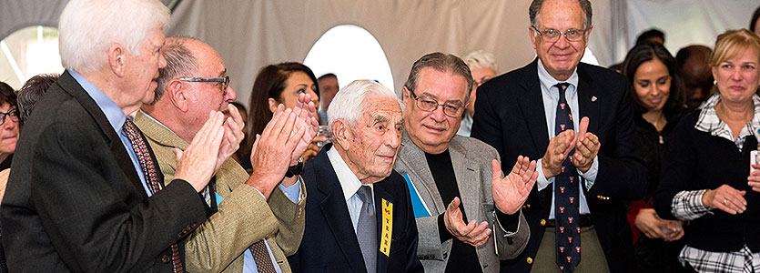 Walter Guralnick, DMD (center, with yellow ribbon), is honored for 65 years of service at Mass General's annual Ether Day celebration.