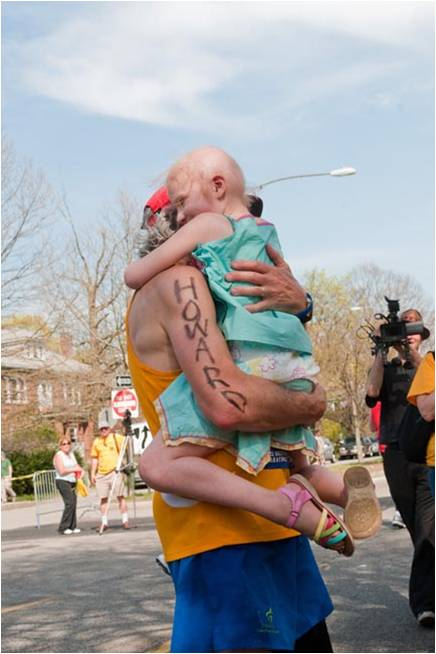 A hug from Lily Waldeck at Mile 20 during the 2012 Boston Marathon inspires Dr. Weinstein to finish.