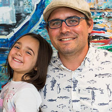 "Artist Jonathan Zuker and members of his family in front of his painting, ""Safe Harbor."" Also pictured are, from left, Abbie, Eliza and Susan Zuker."