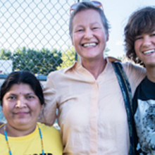 Linnea Duff (middle) and her son Peter (right), volunteering at an event in 2013. Peter volunteers teaching English as a second language to political refugees
