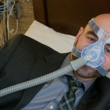 Pictured wearing a medium-sized nasal mask, Matt Bianchi, MD, PhD, says there are numerous options among the masks and other devices used for sleep apnea treatment.