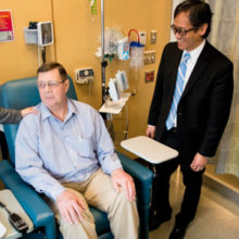 Joseph McGlone (center) checks in with his oncologists, Eunice Kwak, MD, PhD, and Theodore Hong, MD.