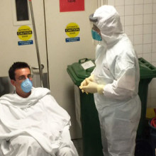A simulated Ebola patient is isolated during a recent drill at Mass General. (Photo courtesy NECN)
