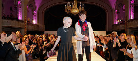 Nicole Schindler and Rachel Bolton, RN, walk the runway at the 2015 Couture for Cancer Care fundraiser.