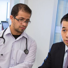 Yi-Bin Chen, MD (wearing tie), here meeting with interns, is researching new treatments related to transplants and leukemia.