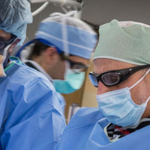 Kenneth Rosenfield, MD (at right), section head for Vascular Medicine and Intervention, performs angioplasty and other procedures with the Institute for Heart Vascular and Stroke Care.